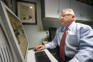 Dr. Sid Savitt O.D. using computer